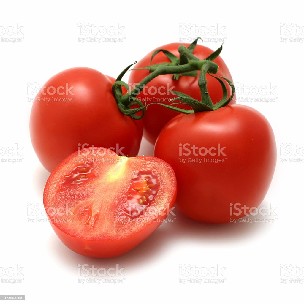 Group of tomatoes on a white background stock photo