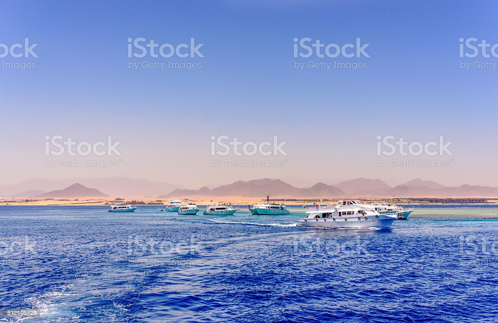 Group of tour ships and dive boats stock photo