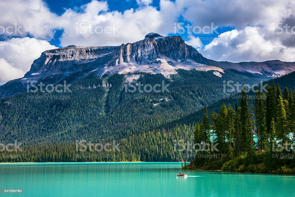 Group of tourists crosses the lake in a rowboat stock photo