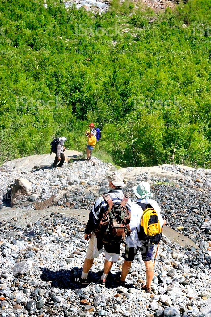 Group of tourists going up to the top of mountain stock photo