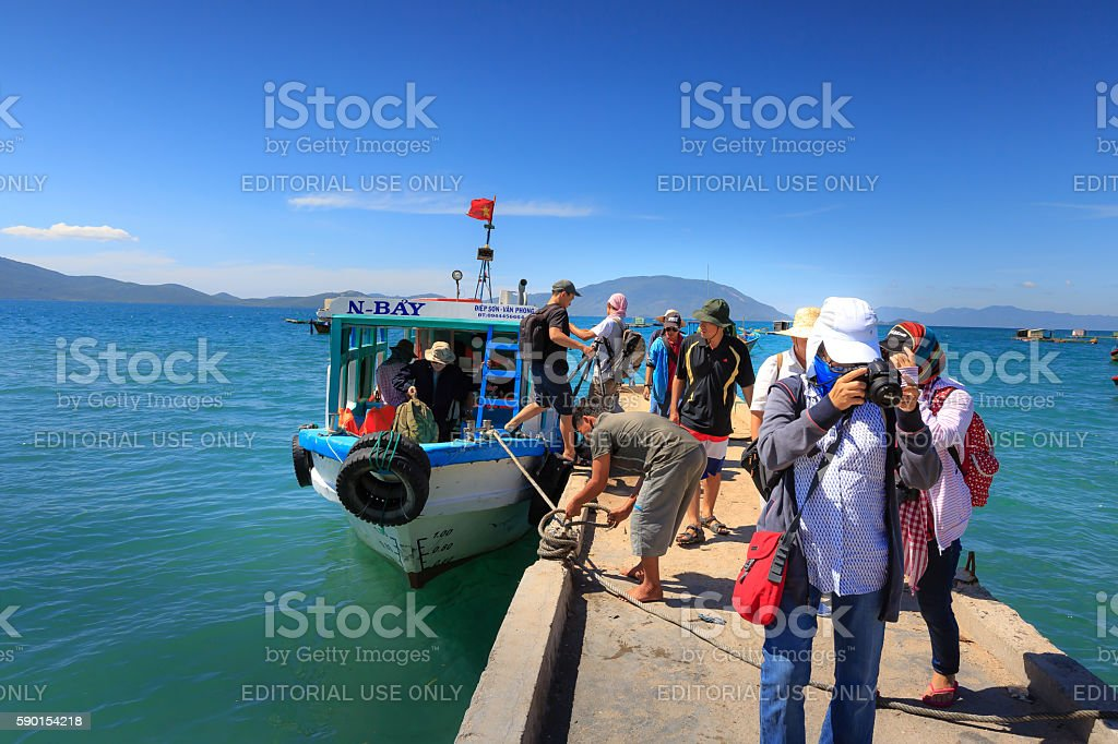 Group of tourists had just docked pier to tour stock photo