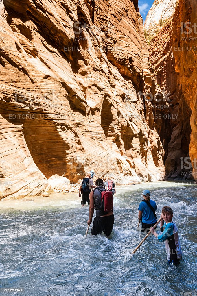 Group of tourists in Narrow canyon in Zion. stock photo