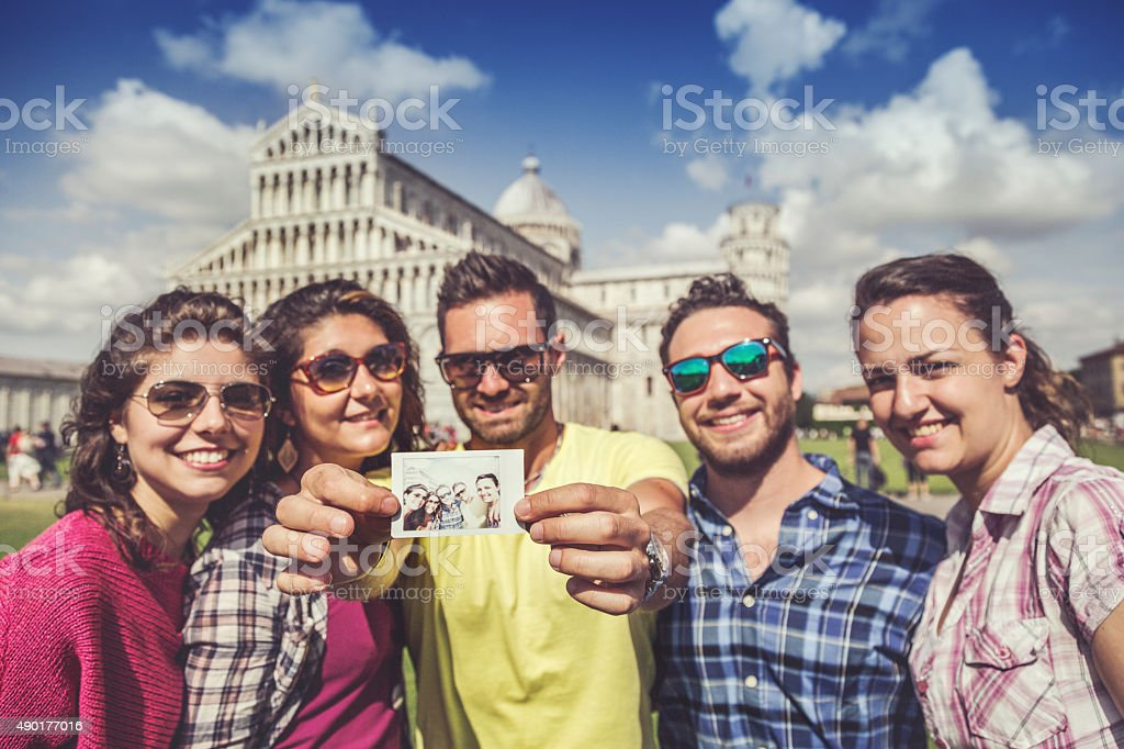 Group of tourists in Piazza dei Miracoli of Pisa stock photo