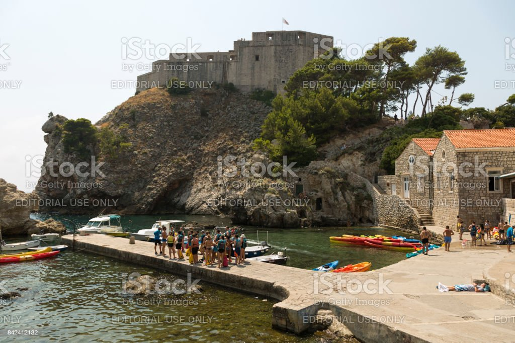 Group of tourists is preparing for a sea excursion. stock photo