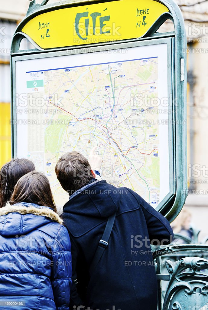 Group of tourists looking at city map, Paris, France stock photo