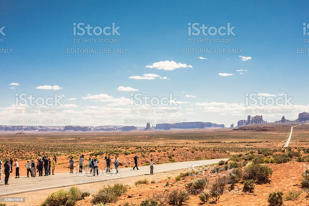 Group of tourists looks Monument Vally stock photo
