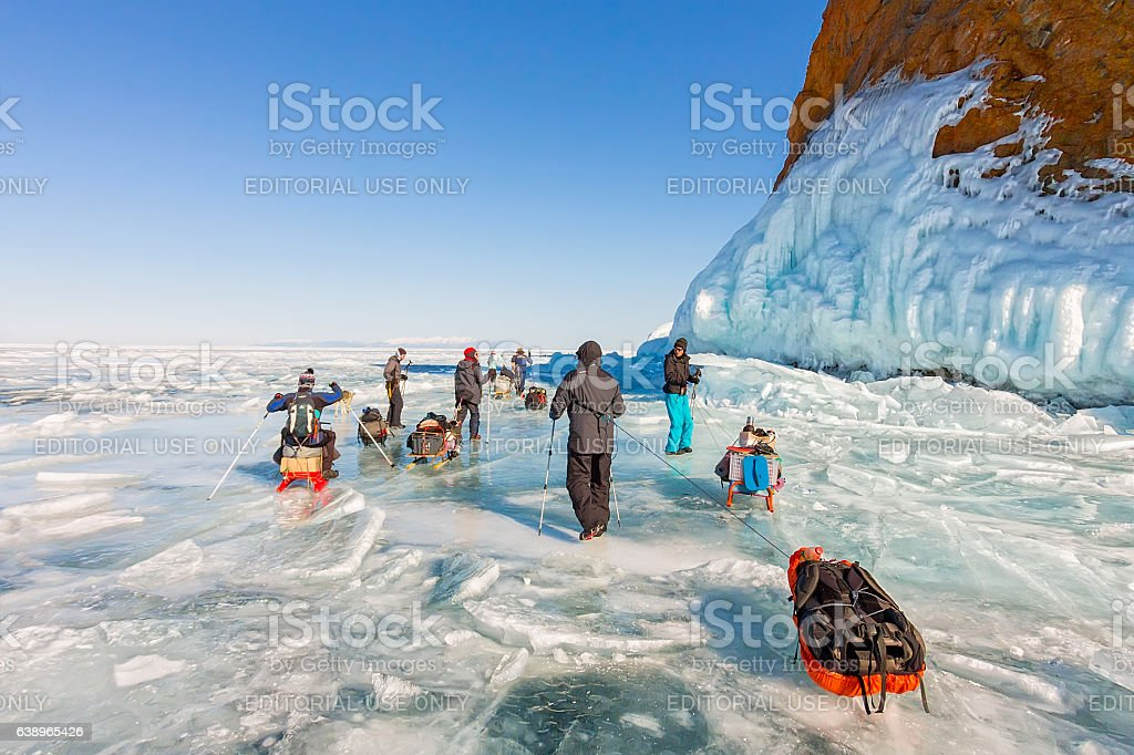 Lake Baikal, Russia - March 24, 2016: Group of tourists stock photo