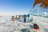 Lake Baikal, Russia - March 24, 2016: Group of tourists