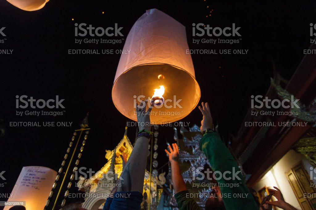 A group of tourists release floating lanterns in Chiang Mai, Thailand stock photo