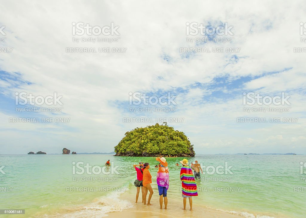 Group of Tourists stand on the beach of Tup island stock photo