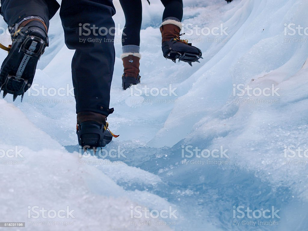 Group of tourists trekking on a glacier stock photo