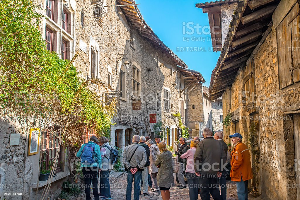 Group of tourists visiting old french medieval village of Perouges stock photo