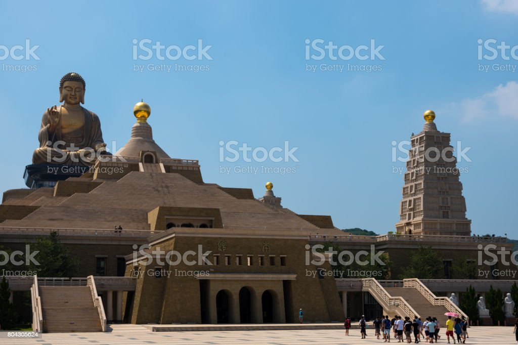 Group of tourists visiting the main temple and large Buddha at the Fo Guang Shan Monastery in Kaohsiung, Taiwan. stock photo