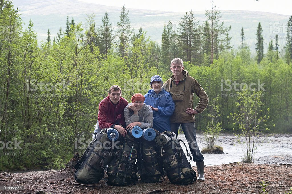 Group of travelers trekking in forest royalty-free stock photo