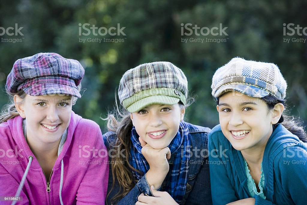 Group Of Tween Girls Lying On Grass royalty-free stock photo