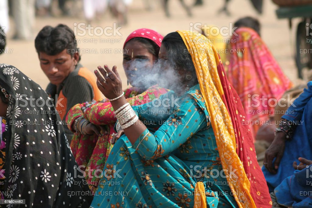 A group of unidentified young Indian nomadic women at Pushkar Camel Fair stock photo