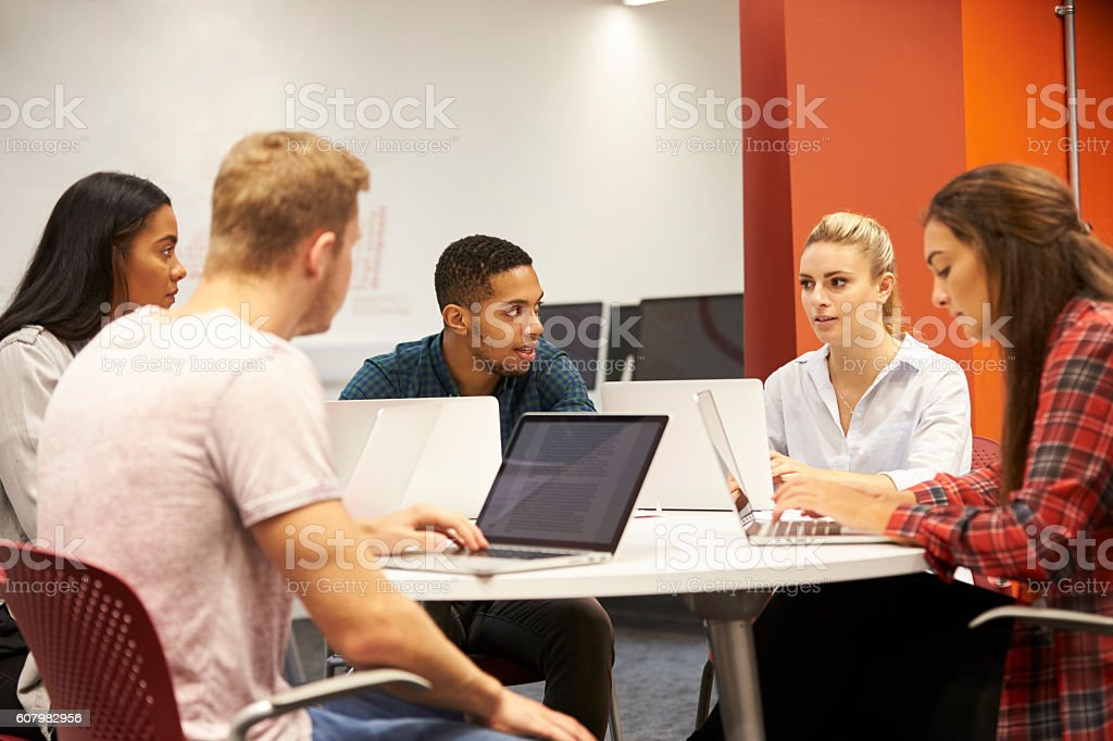 Group Of University Students Collaborating On Project stock photo