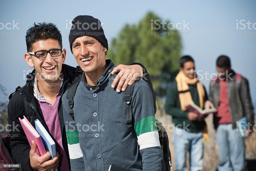 Group of University students having fun together in sunny day. stock photo
