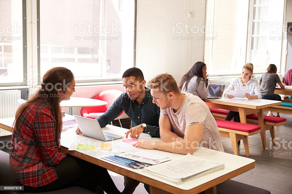 Group Of University Students Working In Study Room stock photo