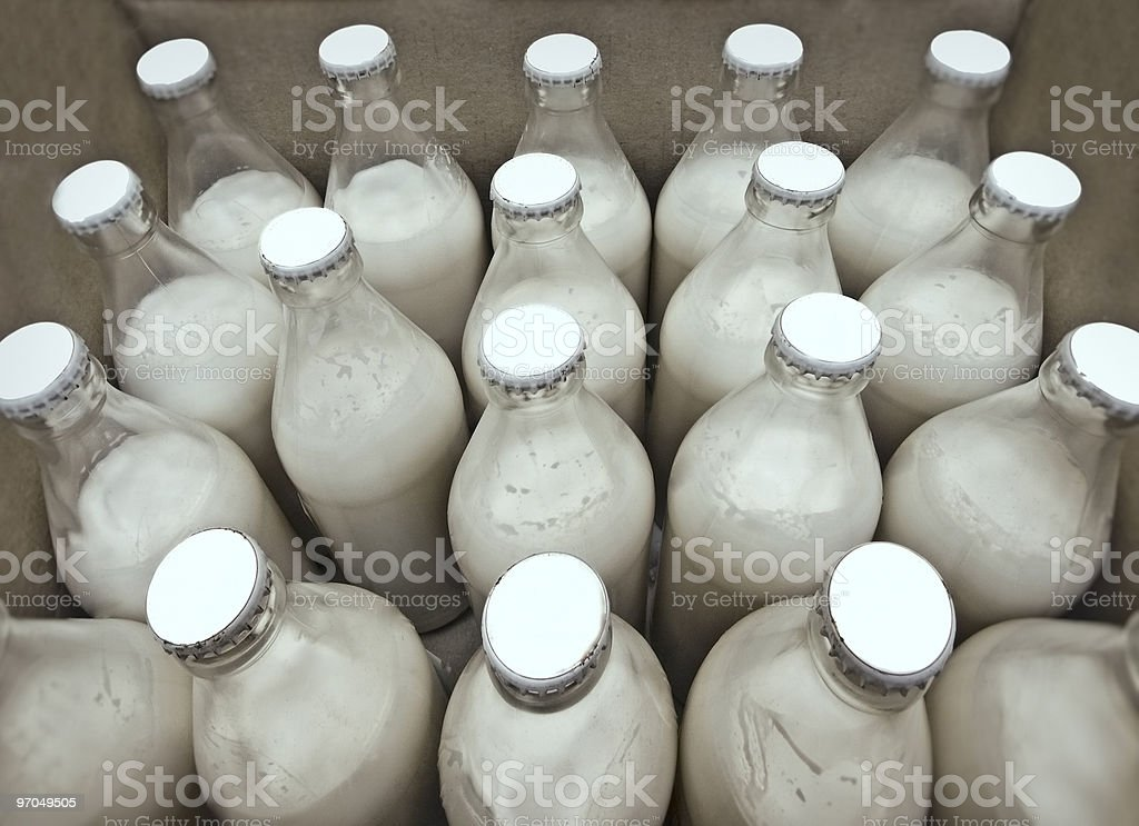 Group of unlabeled glass milk bottles royalty-free stock photo