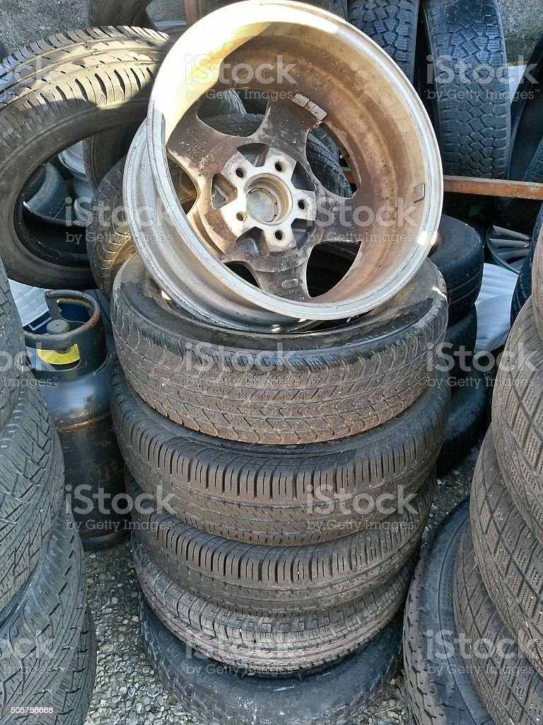 Group of used tires with metal tyre stock photo