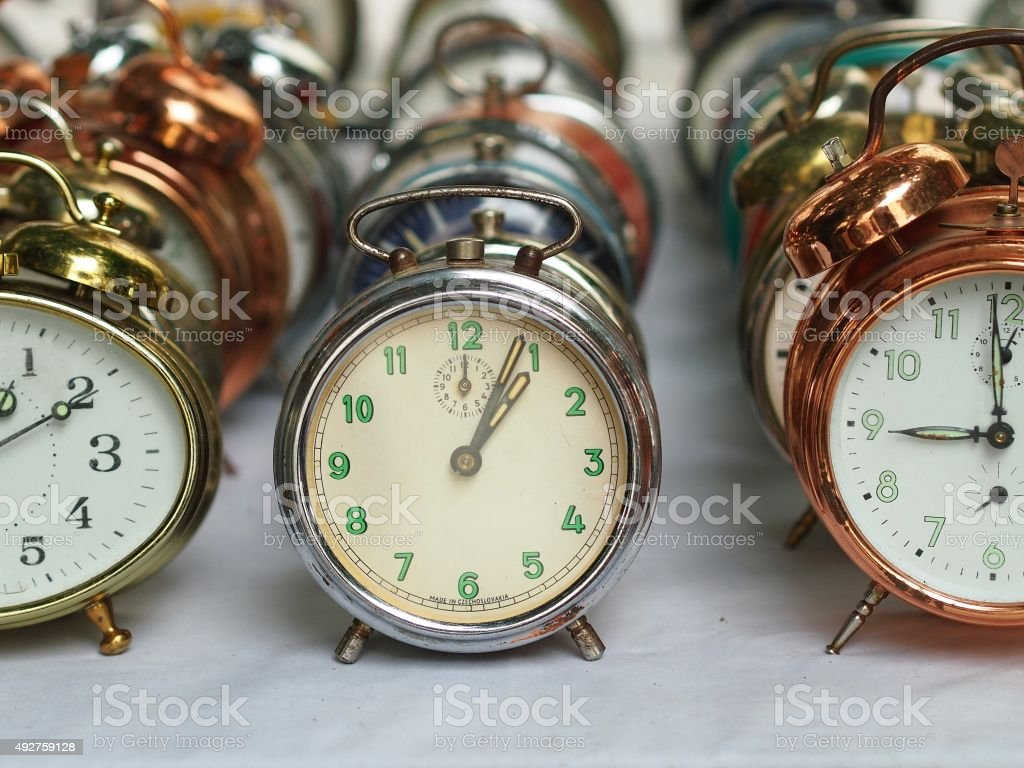 Group of various old alarm clocks stock photo