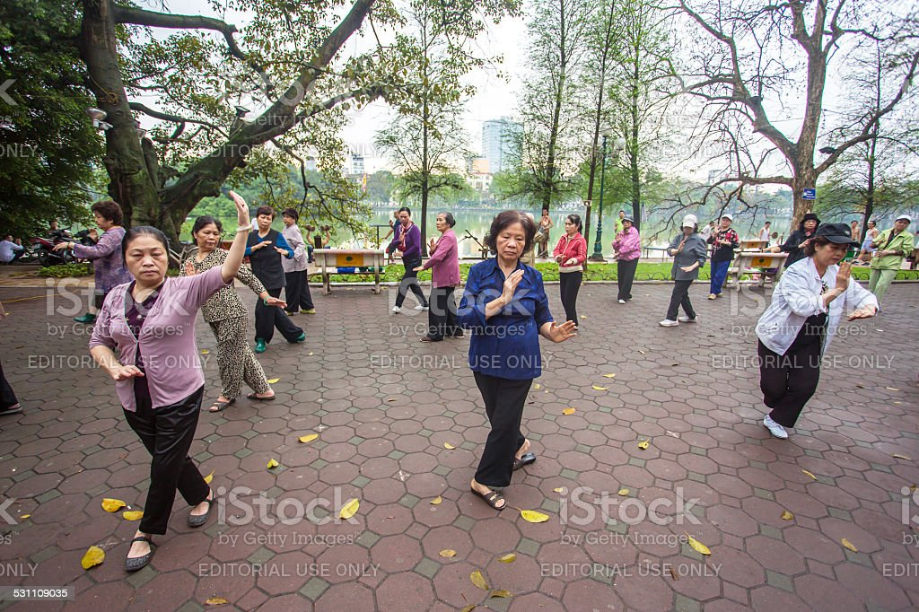 Group of Vietnamese seniors practice Tai Chi stock photo