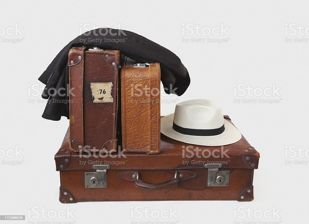 Group of vintage leather suitcases with jacket and hat. royalty-free stock photo