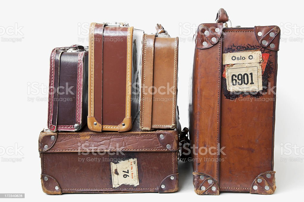 Group of vintage leather suitcases  with labels. royalty-free stock photo