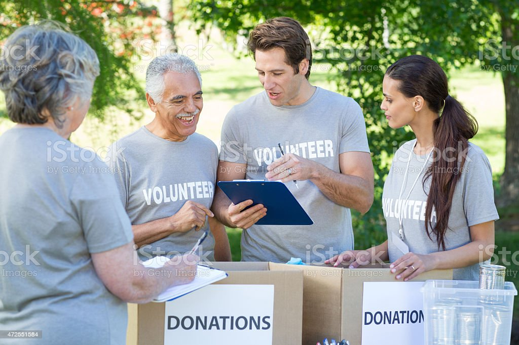 Group of volunteers reviewing donations stock photo