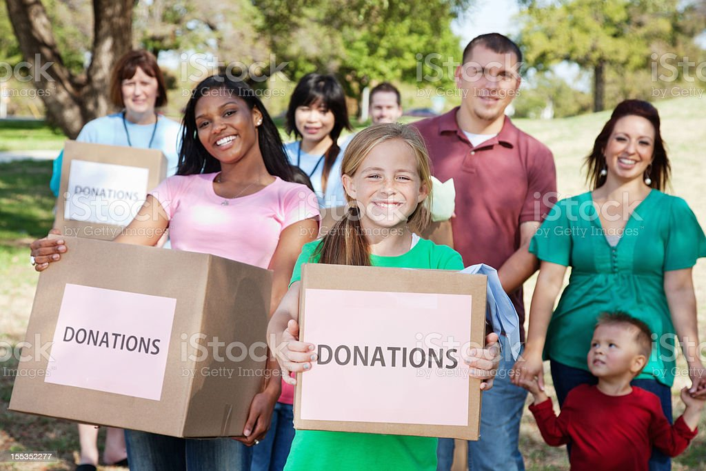 Group of volunteers with donation boxes royalty-free stock photo