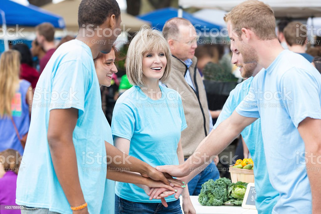 Group of volunteers working together at farmers market stock photo