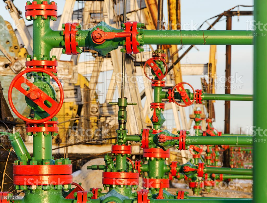 Group of wellheads in the oilfield stock photo