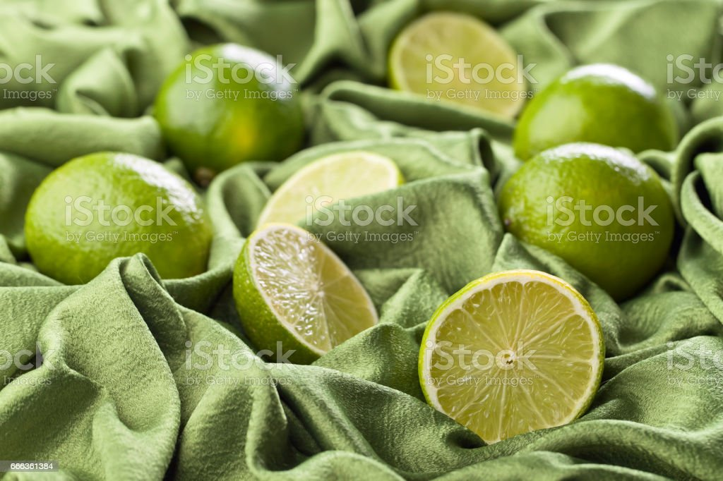 Group of whole and cut fresh limes stock photo