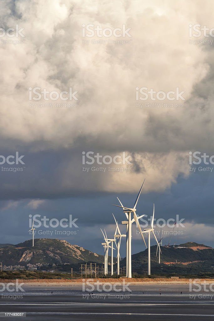 Group of Wind Power Installations in Sunrise royalty-free stock photo