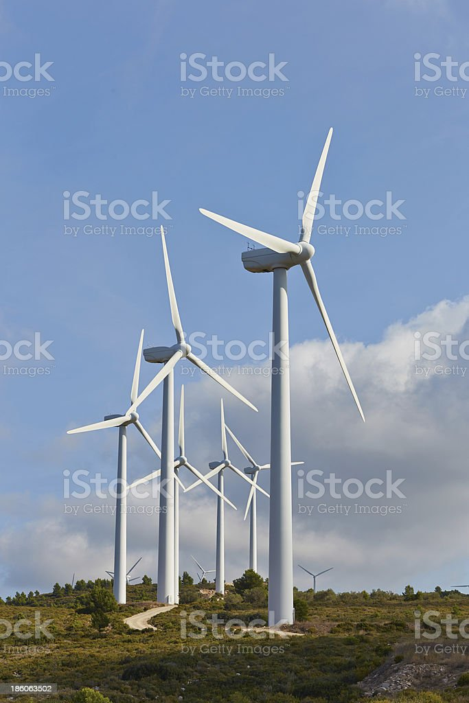 Group of windmills for renewable electric energy production royalty-free stock photo