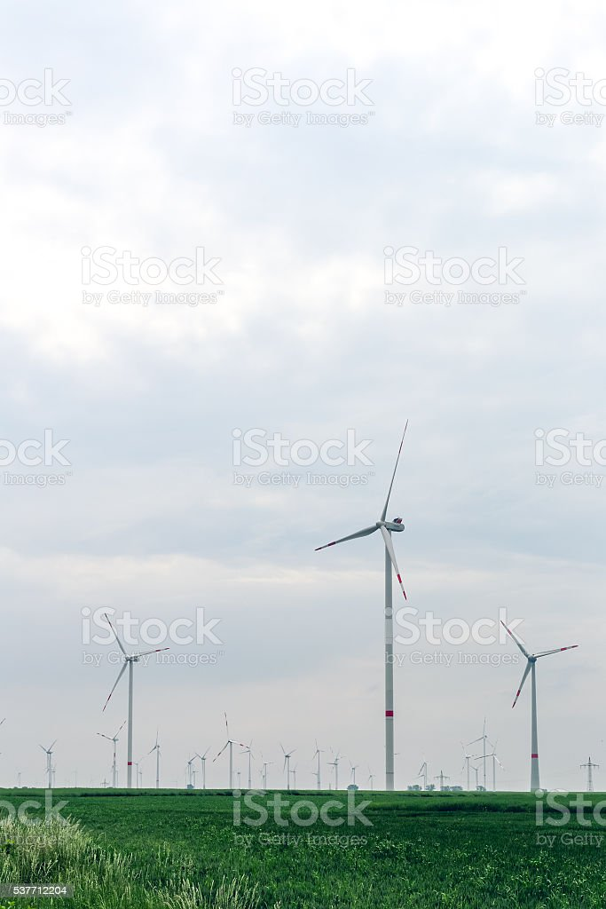 Group of windmills for renewable electric energy production stock photo
