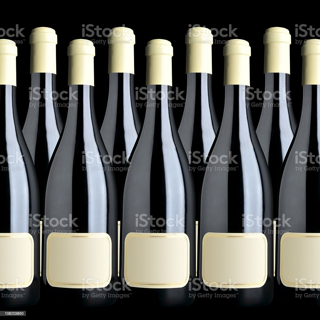 Group of wine bottles arranged in a raw, clipping paths royalty-free stock photo