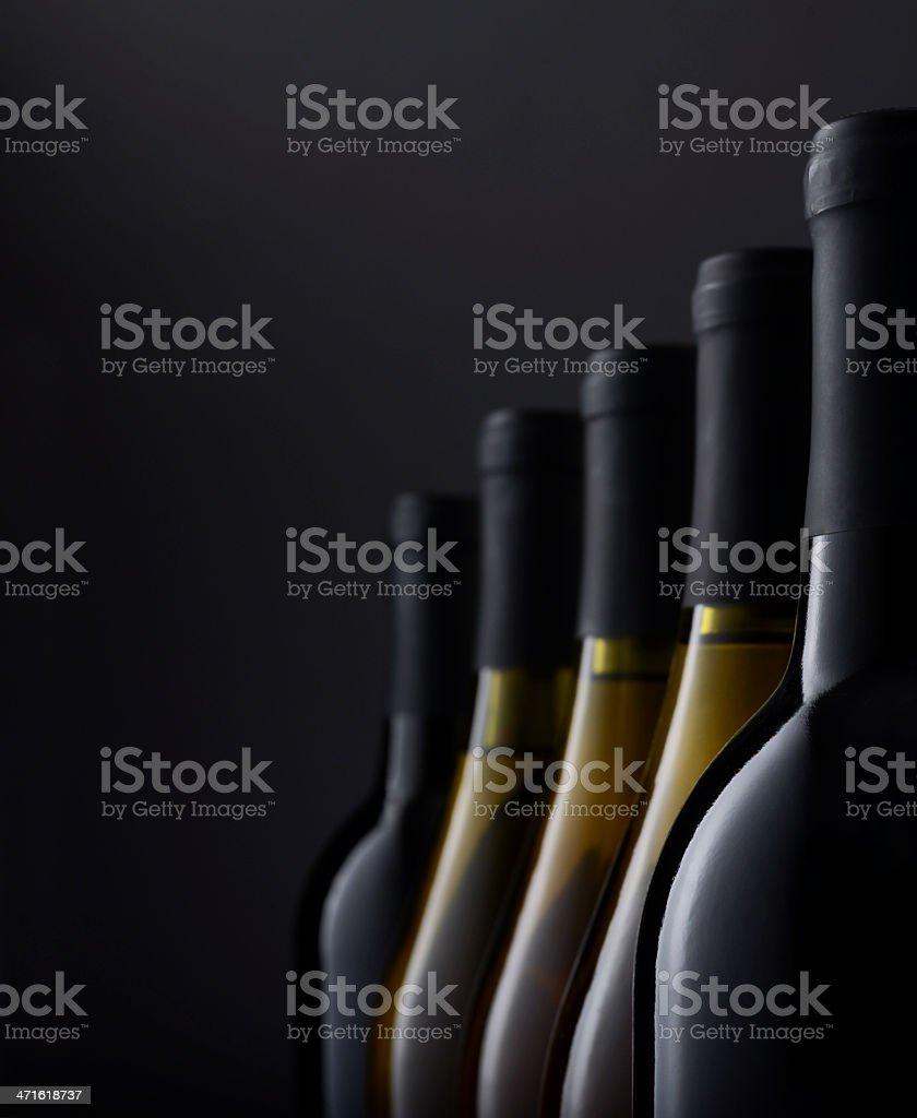 Group of Wine bottles in window light stock photo