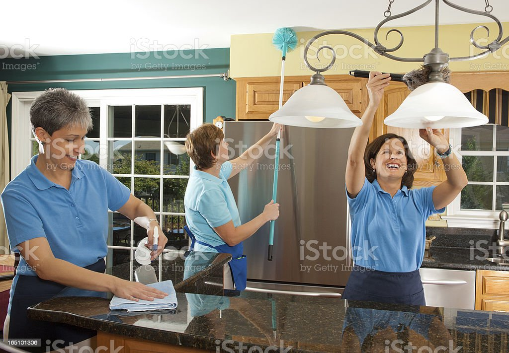 Group Of Woman Cleaning The Kitchen stock photo
