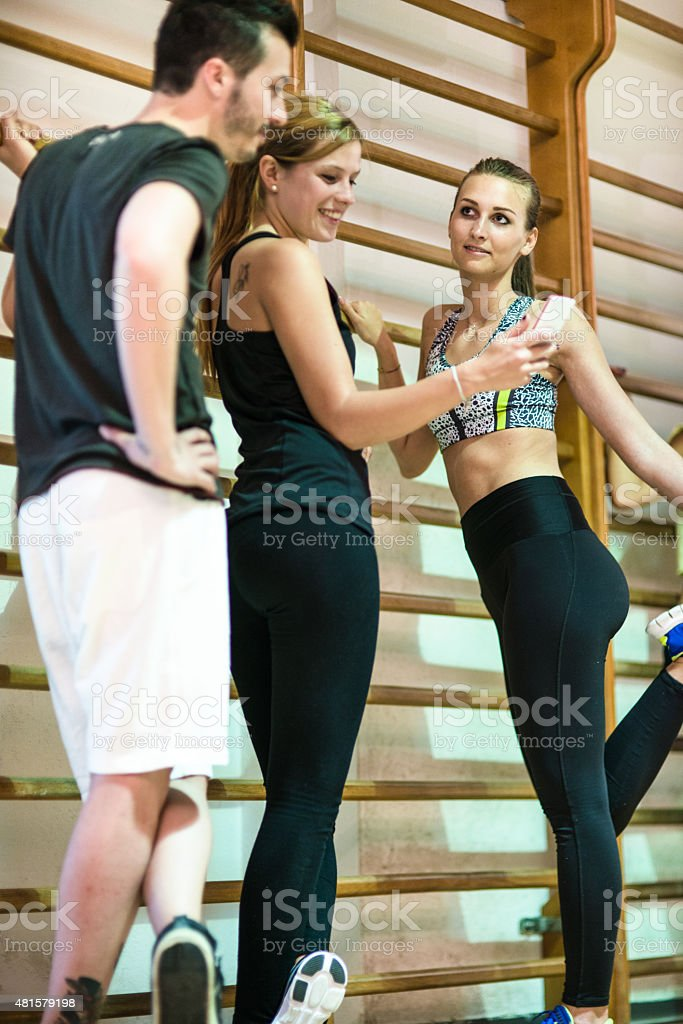 group of woman doing stretching on the gym stock photo