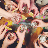 Group of woman drinking tequila shots