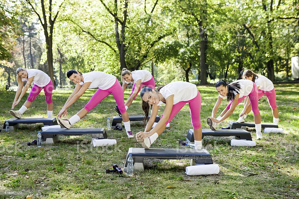 group  of woman stretching royalty-free stock photo