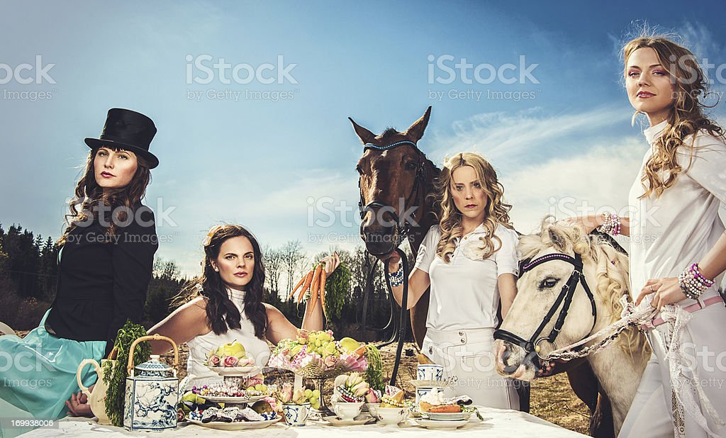 Group of women and horses stock photo