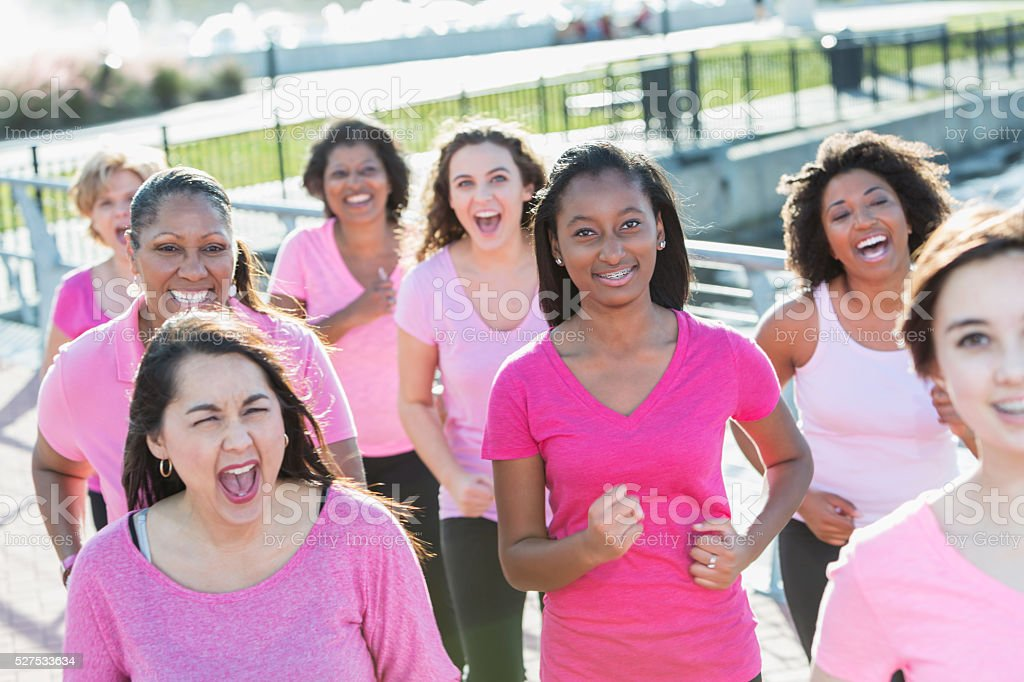 Group of women at rally for breast cancer cure stock photo