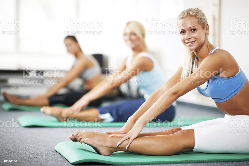 Group of women doing Pilates exercises royalty-free stock photo