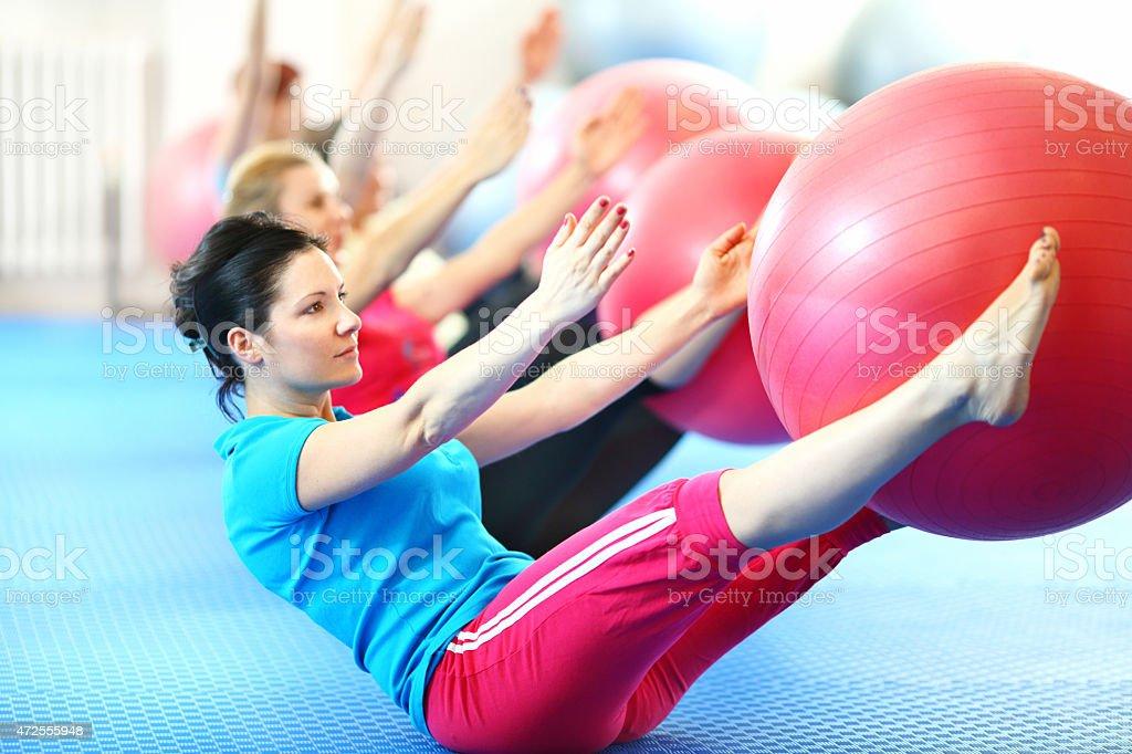 Group of women doing pilates. stock photo