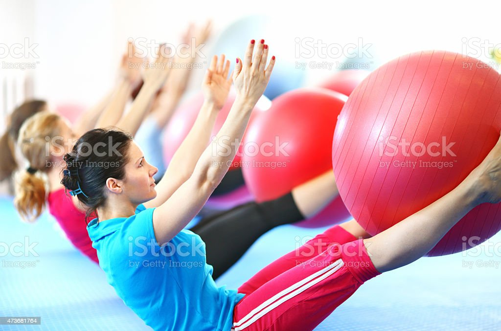 Group of women doing pilates. stock photo