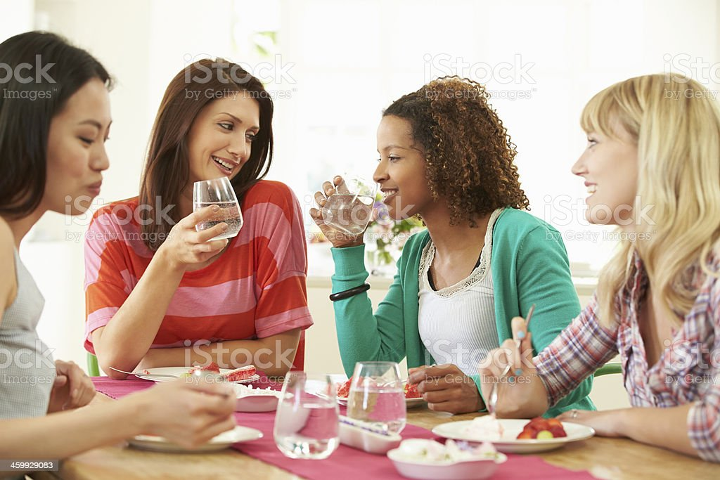 A group of women eating desert at home stock photo