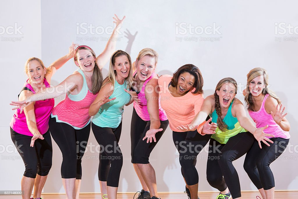 Group of women exercising or dancing, standing in a row stock photo